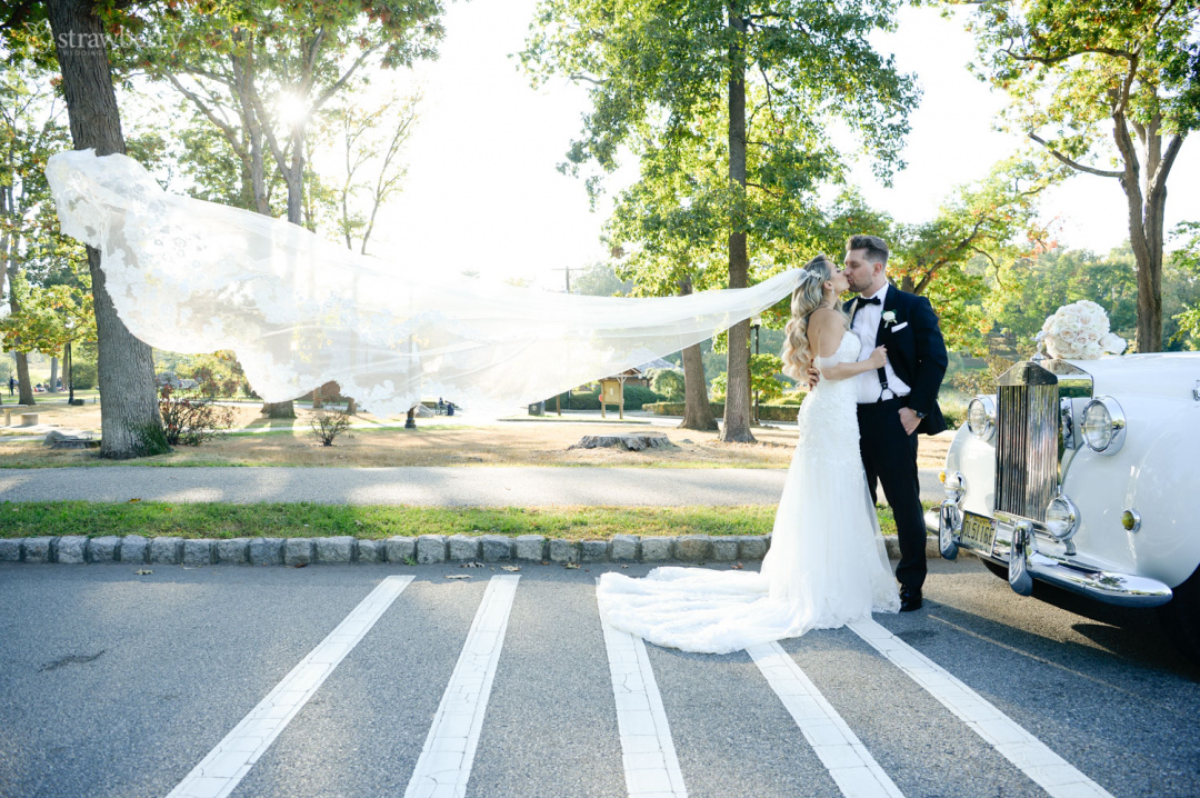 newlyweds-veil-in-the-wind-beautiful-scenery-kiss.jpg