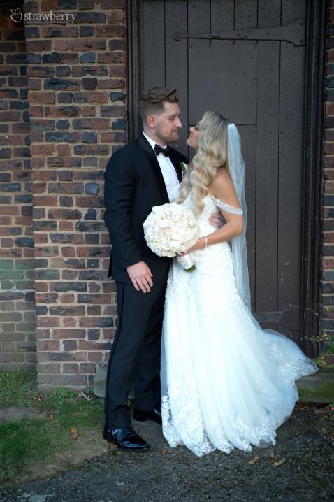 newlyweds-wedding-dress-bouquet.jpg