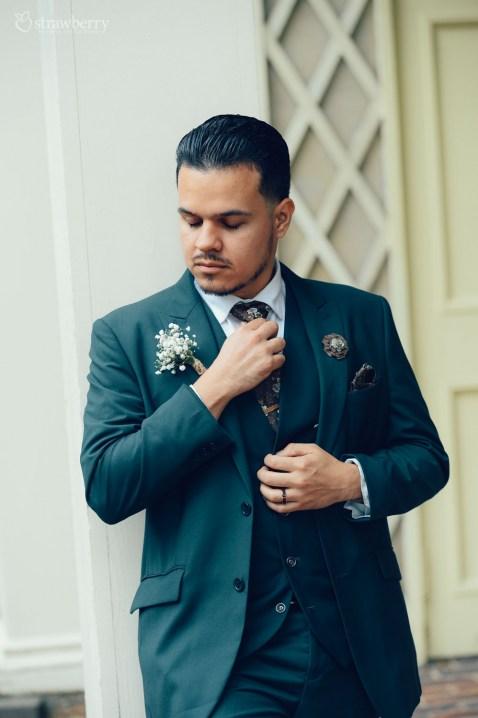 handsome-groom-suit-hold-tie