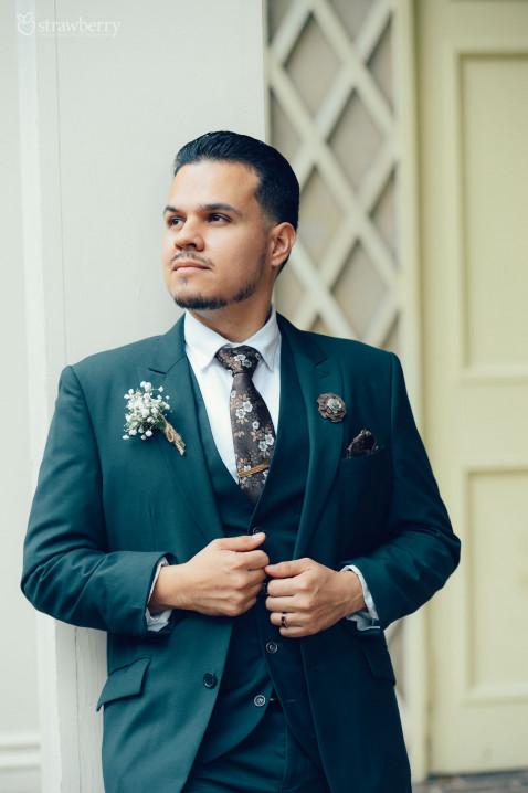 happy-groom-suit-ring-smile-1