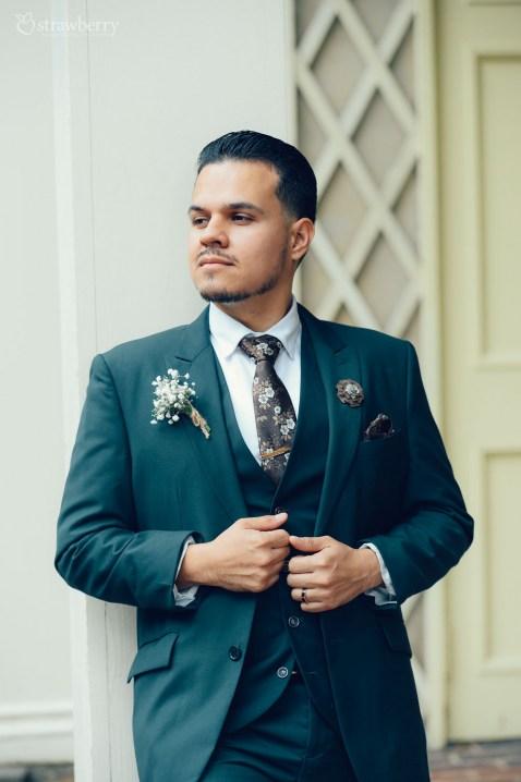 happy-groom-suit-ring-smile-2