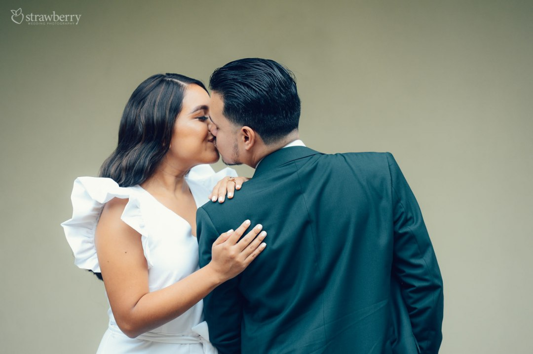 wedding-couple-kissing-ring-together-1