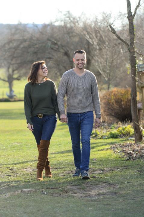 14-engaged-couple-stroll-park.jpg