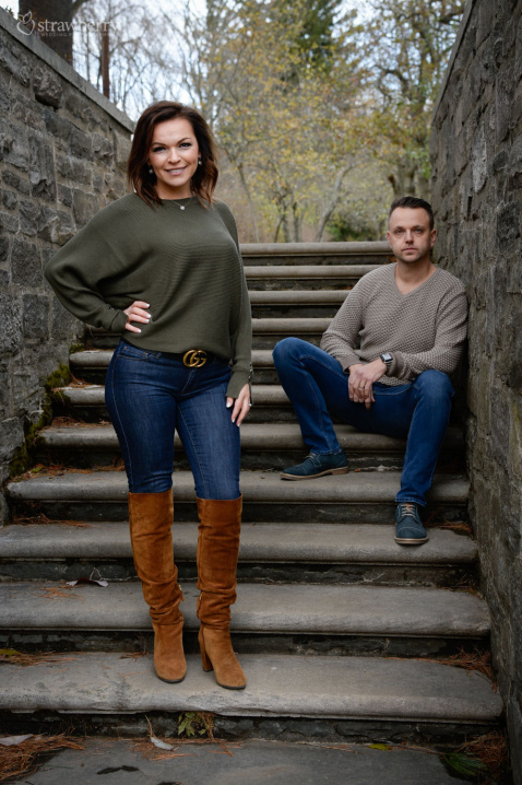 19-engaged-couple-stairs-park.jpg