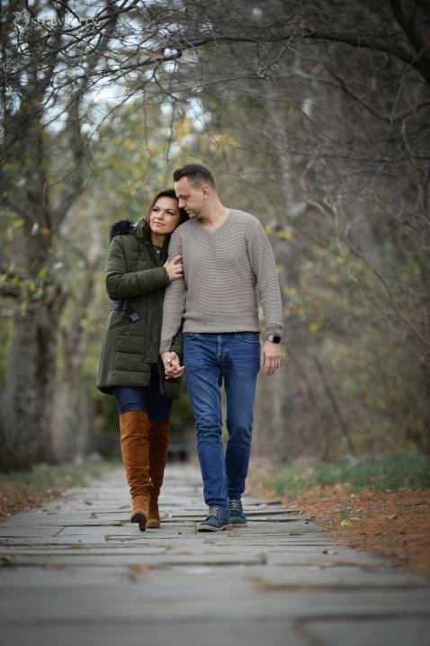 20-engaged-couple-stroll-park-path.jpg