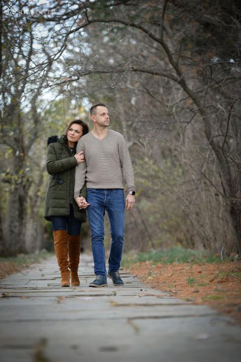 23-engaged-couple-stroll-park-path.jpg