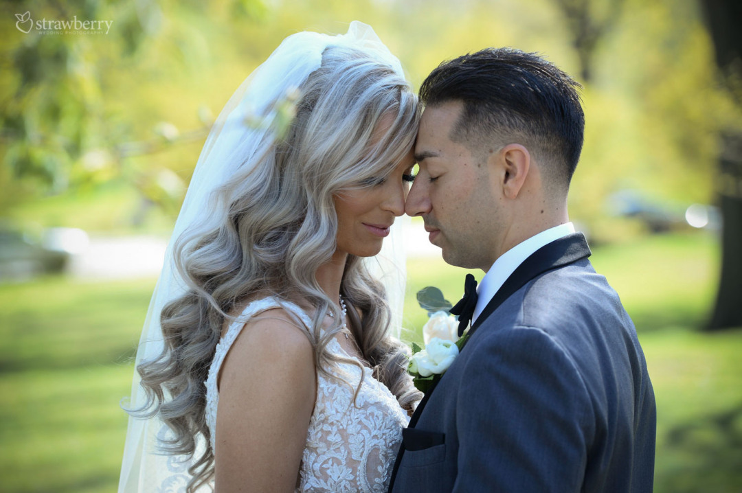 bride-groom-nature-closeness-wavy-hair