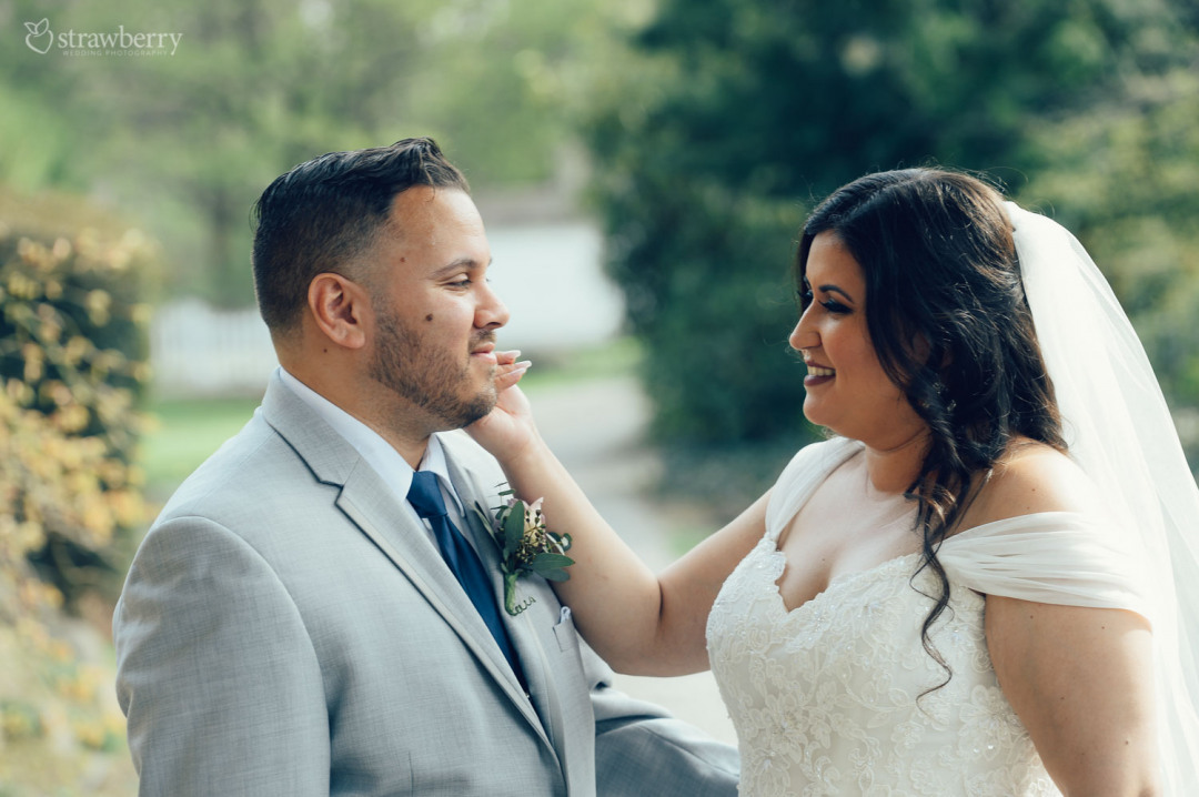 34-newlyweds-caress-nature-park.jpg