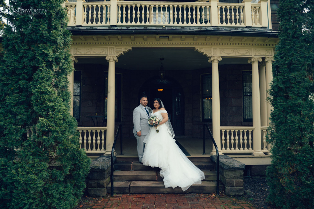 38-newlyweds-wooden-porch-stairs.jpg