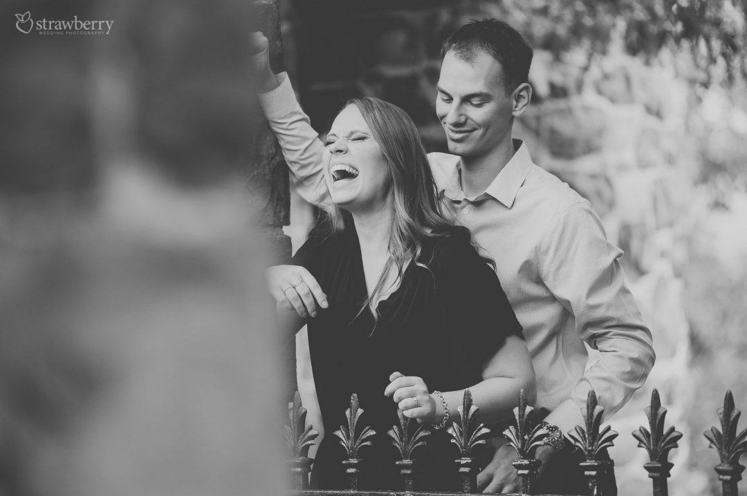 23-couple-hold-fence-laughing-ring-black-white.jpg